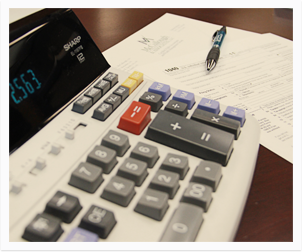 Calculator and tax papers on a desk